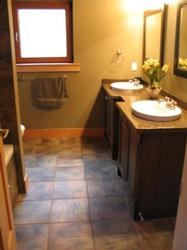 The ensuite bathroom with 2 sinks and heated floors.