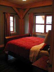 The large queen guest beedroom on the main floor with ensuite bathroom