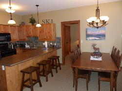 Open-concept kitchen with adjacent dining area - can seat 7 comfortably