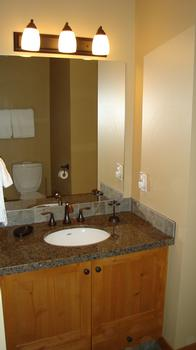 The Ensuite Bathroom with granite counters and upgraded bronze fixtures