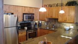 Fully appointed Kitchen with granite counters, stainless appliances and bronze fixtures