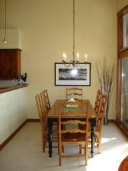 Dining table seats 8 with tall windows/sliding door overlooking deck/views