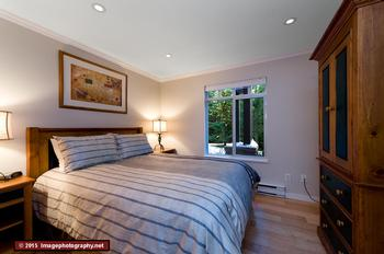 Master bedroom with large window facing the garden. Enjoy a great nights sleep with the queen size bed. The bedroom has a double closet.
