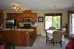 Kitchen has Stainless steel appliances. Seating for 6 in Dining area.