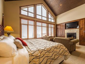 Master bedroom with fireplace, TV and sitting area.