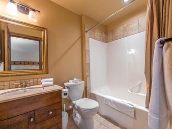 Main bathroom off bunk room with shower and bathtub combination.