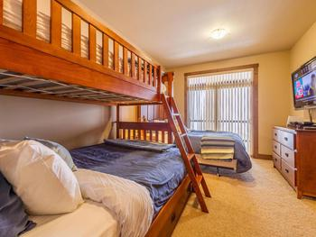 Queen room with single over double bunk. Big HDTV and WII gaming system .