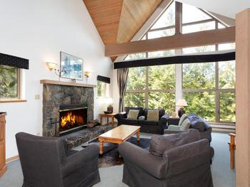 Open Plan Living area with real wood fire place and picture windows
