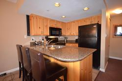 Kitchen features granite counters and new appliances
