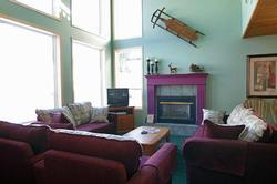 Living Room with floor to ceiling windows looking right up the ski runs