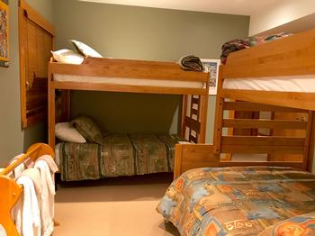 Bunk Bedroom with Double/Single and Single/Single beds, walk in wardrobe and full ensuite bathroom.