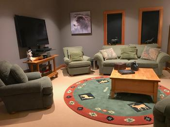 The Adults TV / Media and reading room overlooks the snow capped trees and the ski trails beyond.
