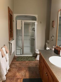 Queen bedroom Ensuite with shower unit incorporating hand held shower head and in-shower seat. Wheel chair storage space provided adjacent to the toilet.