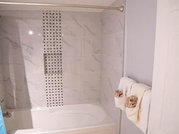 Gorgeous newly tiled bath / shower