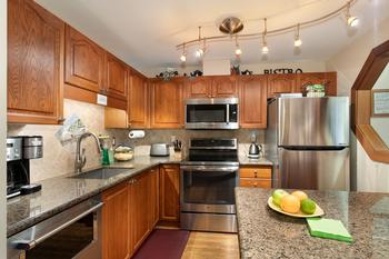 Chef's super-equipped kitchen has been completely renovated,with granite countertops, newer appliances, deep sink, and custom lighting.