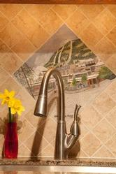 Tile backsplash with hand painted original mural of Whistler Village Square designed by Suquamish, Washington tile artist, Sandra Maddox.