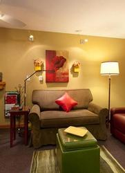 Dimmable decorative wall lights above sofa in the living room area.