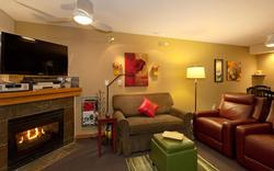 Wintertime photo of living room with amber glass shaded wall lights and LED bendable floor lamp.