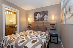 The Master Bedroom includes Queen bed, en suite bathroom and 32-inch flatscreen TV with cable access.