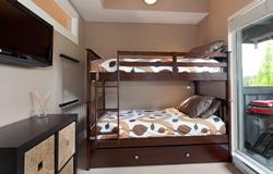The fun Bunk bedroom provides a single Trundle under the lower bunk, cathedral ceilings, 32-inch flatscreen TV with cable and DVD player, and direct access to the private deck.