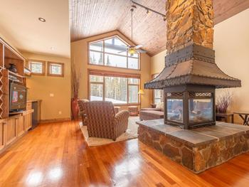 Large windows in the living room area. Relax in front of the fire and watch the skiers go by.