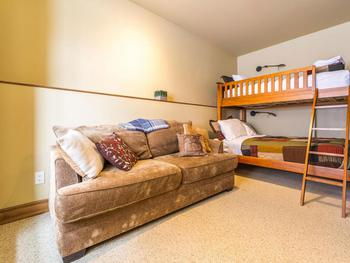 Queen sofa bed and single over double bunks in the entry level bedroom.