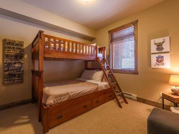2nd bedroom with single over double bed and a single trundle bed.