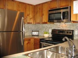 Rennovated, fully stocked kitchen with all new appliances! Listen to music on our stereo with DVD/ipod capabilities and have a glass of wine while making your meal!