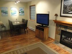 Enjoy the large LCD television, Blu-ray DVD player, stereo with iPod docking, gas fireplace, and drinks!