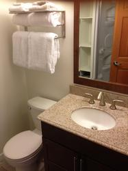 A new washroom with granite counter top, shower, and lots of storage for your toiletries.