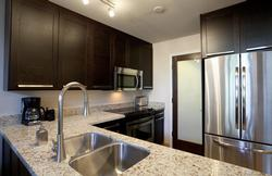 Stylish kitchen with all new appliances, granite counters and lots of room for your groceries.