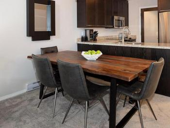 Large dining room table provides comfortable seating for 6.