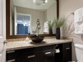 Stylish en-suite half-bathroom, with vanity and toilette. Laundry room directly across the hall from our unit.