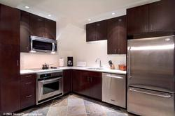 Gourmet Kitchen with new stainless appliances, granite counters, and fully equipped !