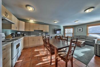 Enjoy a warm cooked meal in this roomy kitchen.