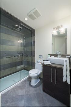 Shared bathroom for bunk rooms with full shower.