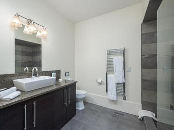 Queen master ensuite with heated floors and steam shower.