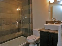 Main bath located on second floor adjacent to guest rooms. Heated floors and a steam shower.