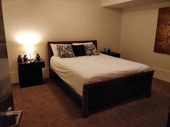 Queen room on main floor with TV and DVD player.