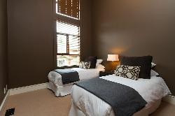 Bedroom #4: 2 twin beds that can be set up as a king bed upon request. Top floor