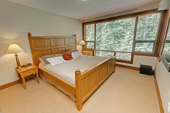 Master bedroom comes with a king size bed, 55 inch tv, and great over size windows.
