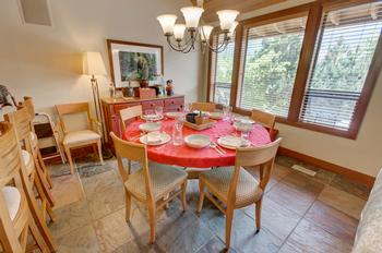 Enjoy dining in style, beautiful round table and great views of the mountains while you dine !