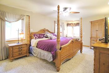 Master suite with King size poster bed, 1200 count Egyptian cotton sheets, walk-in closet, satellite TV and sitting window.