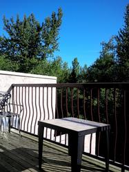 Relax and enjoy your morning coffee on the large deck which over looks the ski hill.