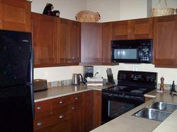 Fully equipped kitchen with eating bar. Open to dining and living areas