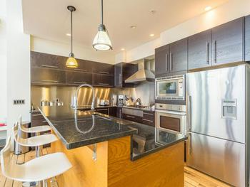 The dream kitchen is beautifully finished with state of the art appliances. Appliances include a 6 burner counter top gas range, 2 drawer dishwasher, convection oven & microwave.