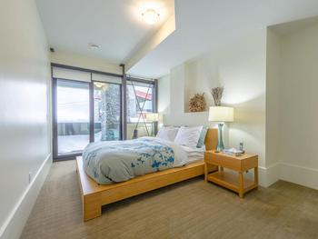 Bright and airy queen bedroom on second floor with ensuite/shared bathroom.