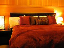 the warmth of solid wood in the master and guest bedrooms