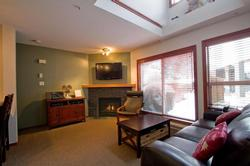 Lofted livingroom area with relaxing fireplace, HD TV, xBox 360, DVD player and movies all ready for your enjoyment.