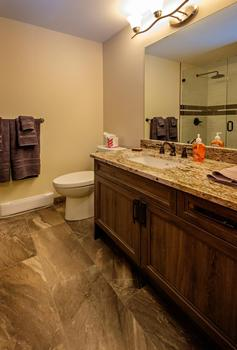 Private master bathroom with large walk-in shower.